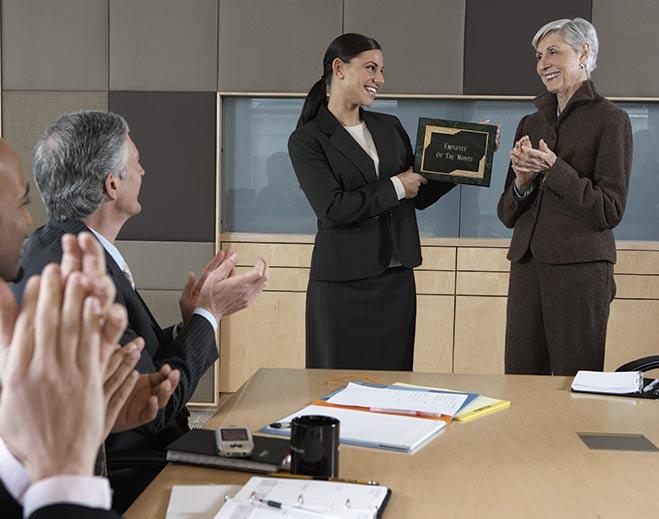 award-executives-applauding-woman-standing-up/